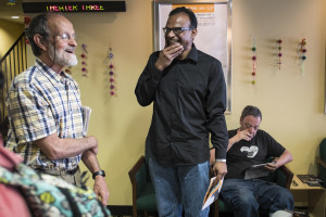 Director Jayan Cherian and Ohio University Professor Gene Amarell share a laugh in the lobby of the theater prior to the screening of Cherian's film Papilio Buddha. Professor Amarell brought his class to see the film about Buddhism in India.