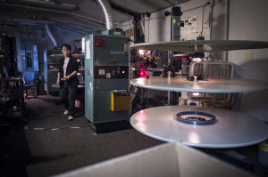 The Athena's Head Projectionist, Hsin-ning Chang, prepares a show in the projection booth at the theater.
