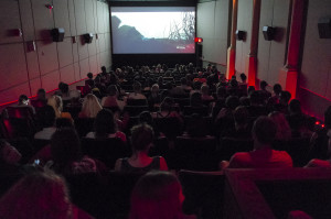 An audience in one of the Athena's downstairs theaters takes in a show at the 40th Athens International Film and Video.